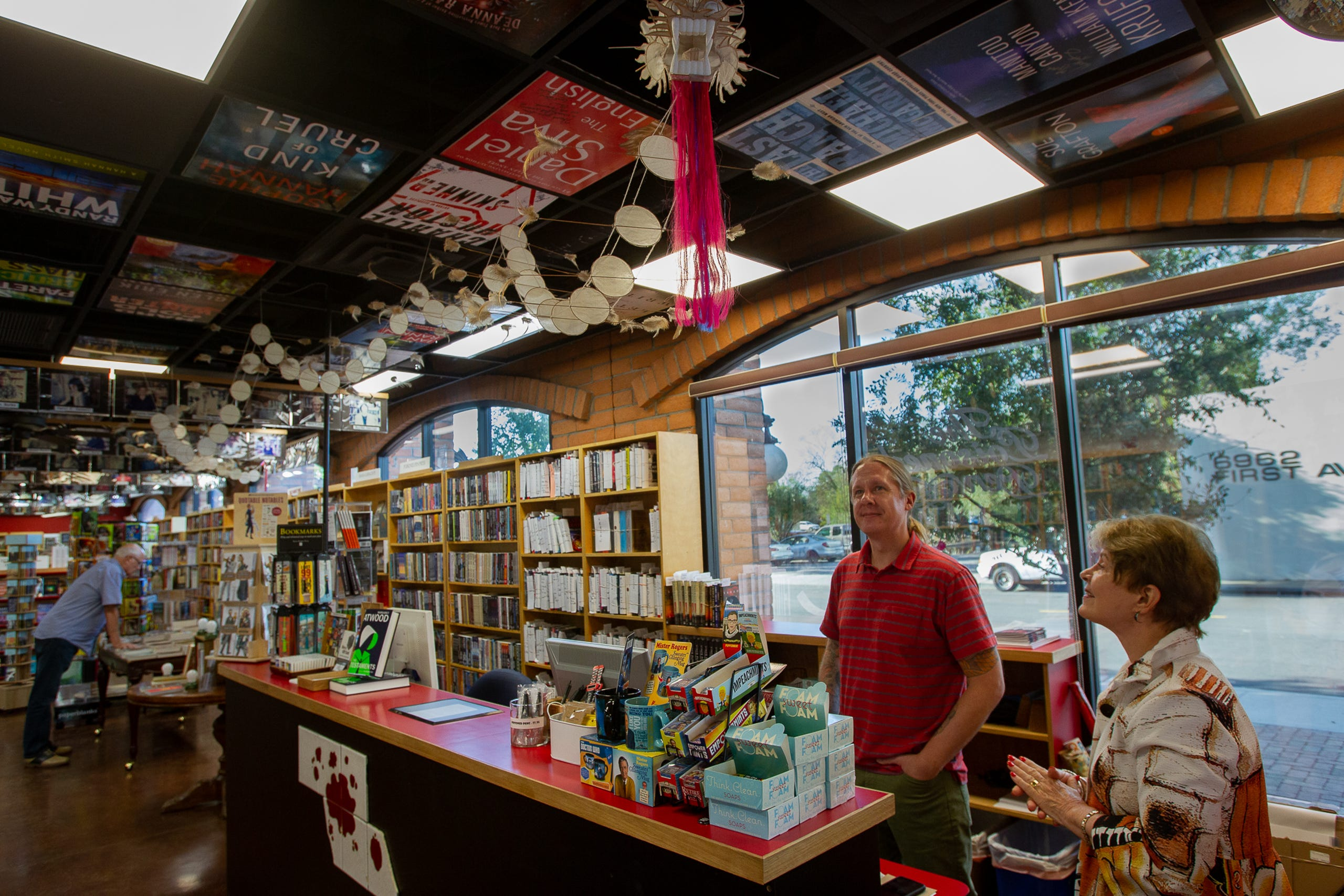 Posters of book covers, photos famous visitors and a large paper dragon are just some of the items decorating Poisoned Pen Bookstore, September 24, 2019.