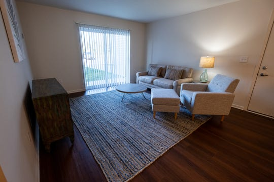 The living room in a model apartment at Dutton Estates in St. Clair. Construction on the complex is wrapping up, and it is expected to be completely open in the next week.