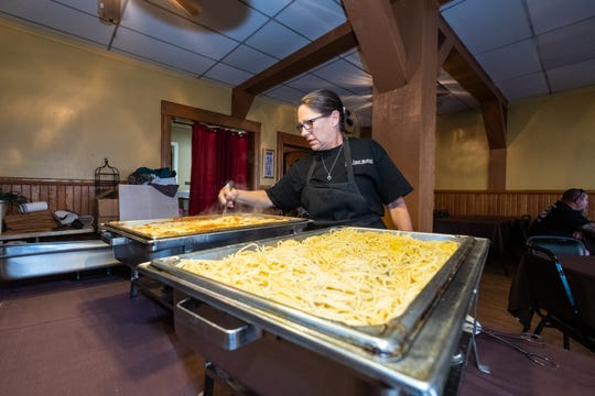 Shelley O'Brien, owner of the Yale Hotel, works to prepare food Thursday, Sept. 26, 2019, in the hotel's dining room. O'Brien is offering free meals to families affected by the General Motors strike.