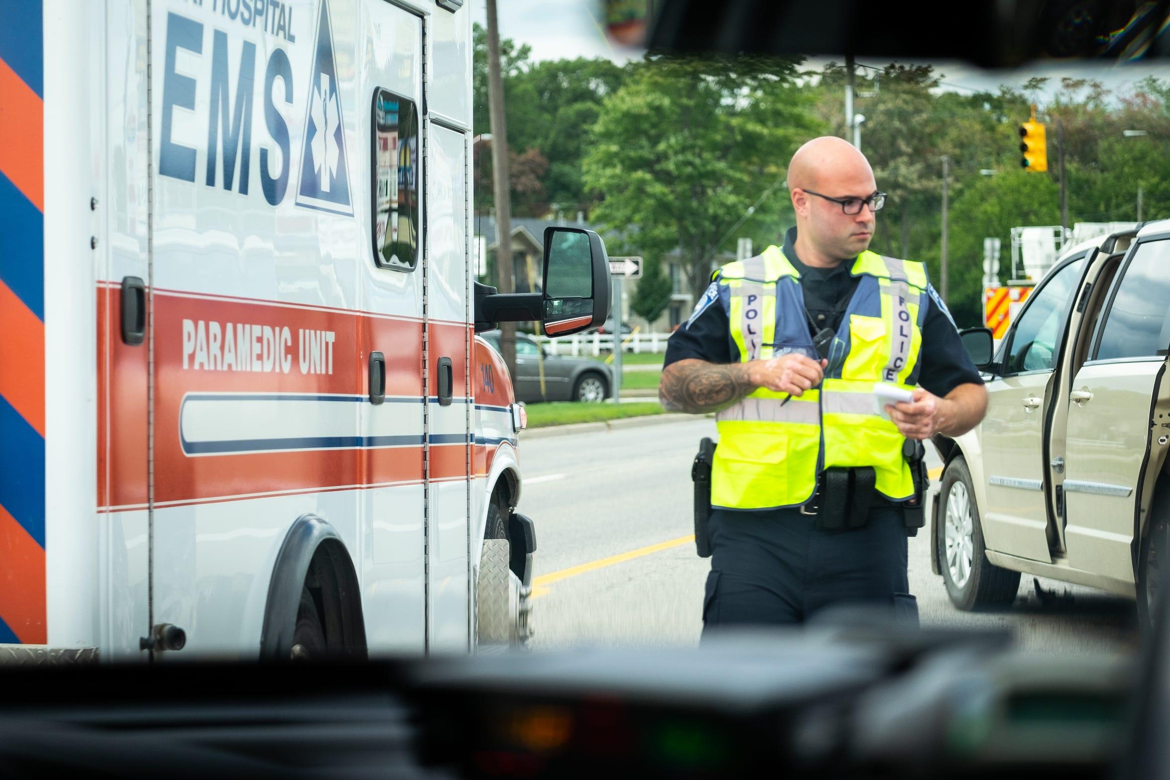Port Huron Police Patrol Officer Sam Baker responds to a crash on Pine Grove Avenue Wednesday, Sept. 25, 2019, in Port Huron.