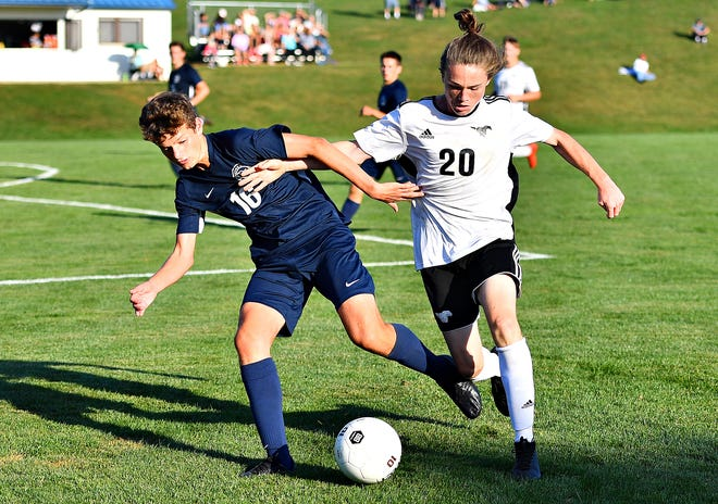 Dallastown's Blake Pitzer, left, and South Western's Austin Hartlaub compete for control of the ball during boys' soccer action at Dallastown Area High School in York Township, Thursday, Sept. 26, 2019. Dallastown would win the game 3-0. Dawn J. Sagert photo