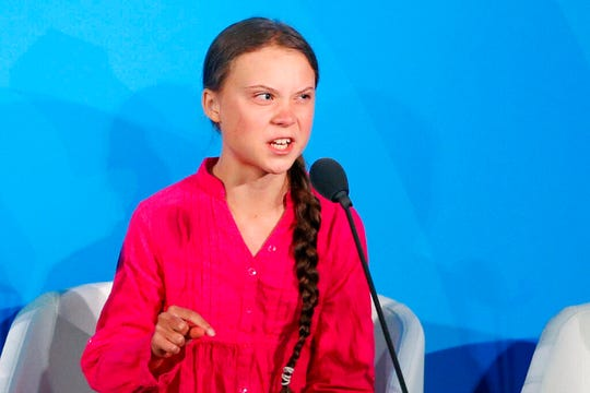 "Environmental activist Greta Thunberg, of Sweden, addresses the Climate Action Summit on Monday, Sept. 23, at the United Nations General Assembly at U.N. headquarters. She gives mostly emotionless talks, but on Monday, she shed the stick-to-the-science message and frequently choked up when she scolded world leaders at the United Nations, repeating the phrase ""how dare you"" over and over in a highly praised address. (AP Photo/Jason DeCrow)"