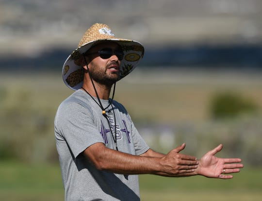 Spanish Springs' head football coach Rob Hummel give instructions during practice on Aug. 14.