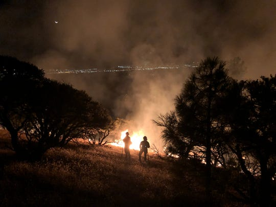 Firefighters work on the Evans Creek Fire in a remote corner near southwest Reno on Thursday, Sept. 26.