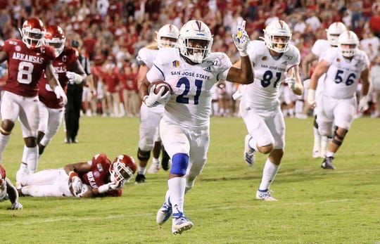 San Jose State running back DeJon Packer (21) rushes for a touchdown late in the fourth quarter against Arkansas.