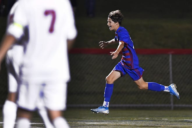 Fairport's Garrett Kucera celebrates his game-tying goal in the closing seconds of the first half against Penfield during a regular-season game at Fairport High School, Wednesday, Sept. 25, 2019. Fairport and Penfield played to a 1-1 draw.