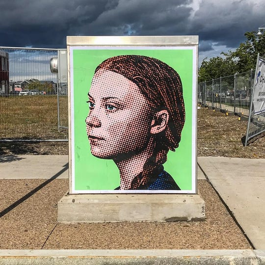 One day after climate-change activist Greta Thunberg's fiery U.N. address, Rochester artist Mike Dellaria (aka Dellarious) installed a wheat-paste portrait of the Swedish teenager on a utility box in the East End.