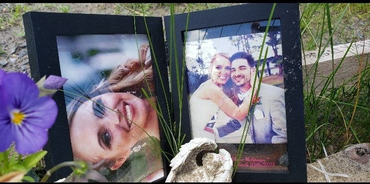 Wedding photos of Erin and Shane McGowan, of Amsterdam, placed at the crash site. They were married in June 2018.