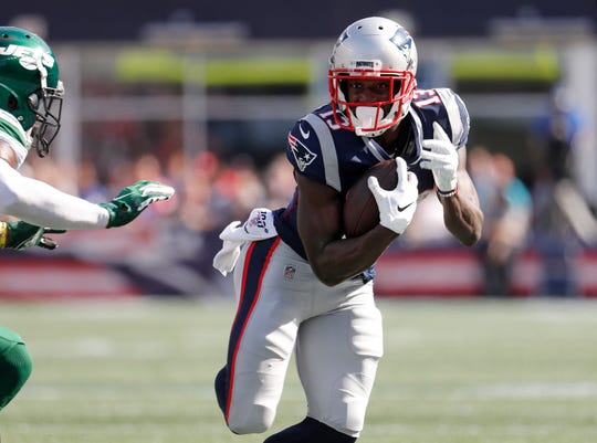 New England Patriots wide receiver Phillip Dorsett runs the ball during an NFL football game against the New York Jets at Gillette Stadium, Sunday, Sept. 22, 2019 in Foxborough, Mass.