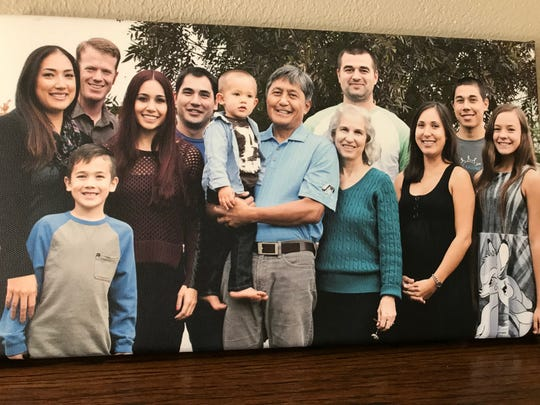 John Adena's extended family poses for a family portrait. John Adena stands fourth from the left.