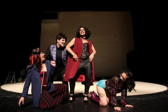 Margo Schembre as Magenta, from left, Nicholas D. G. Hikes as Riff Riff, Rhansen Mars as Dr. Frank-N-Furter and Cassandra Pangelinan as Columbia perform a song during a rehearsal for The Rocky Horror Show at Salem's Historic Grand Theatre on Sep. 25, 2019.