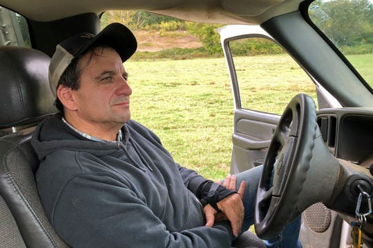 In this photo taken Sept. 20, 2019, rancher Jerome Rosa, who is executive director of the Oregon Cattlemen's Association, sits in his pickup truck in Marquam, Ore.  The Trump administration's trade war is affecting Oregon's agricultural exports more than most states because 40% of the state's agriculture production is sent abroad. That's compared to 20% for the rest of the U.S. The heads of the associations representing Oregon's wheat and hazelnut farmers and cattle ranchers recently joined the director of the state agriculture department to describe the toll to state lawmakers. They say sales of beef and wheat to China have halted.