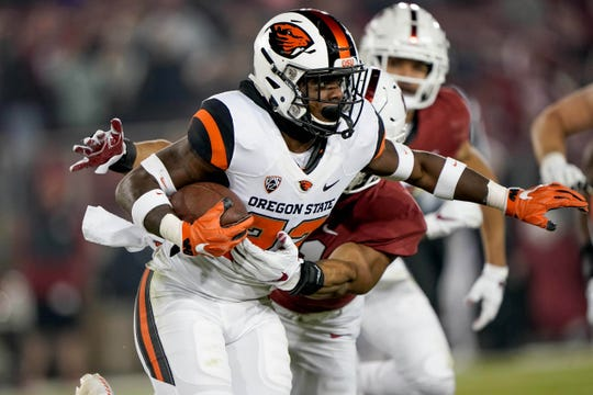 Nov 10, 2018; Stanford, CA, USA; Oregon State Beavers running back Jermar Jefferson (22) runs against the Stanford Cardinal during the second quarter at Stanford Stadium. Mandatory Credit: Stan Szeto-USA TODAY Sports