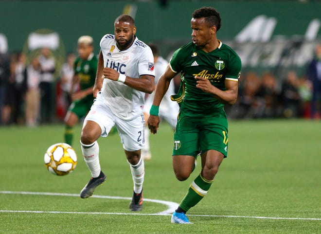 Portland Timbers' Jeremy Ebobisse is trailed by New England Revolution's Andrew Farrell (2) during an MLS soccer match Wednesday, Sept. 25, 2019, in Portland, Ore.
