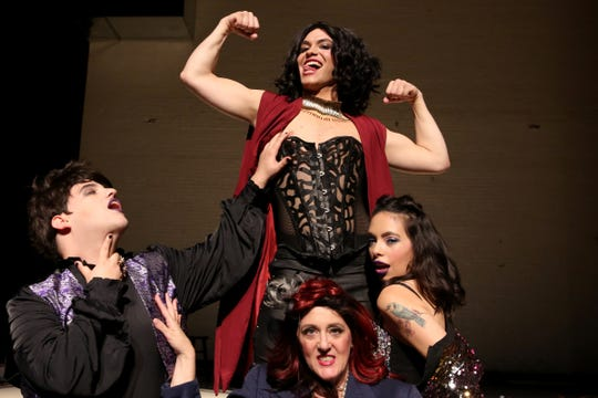 Rhansen Mars, clockwise from top, as Dr. Frank-N-Furter, Cassandra Pangelinan as Columbia, Margo Schembre as Magenta and Nicholas D. G. Hikes as Riff Riff perform a song during a rehearsal for The Rocky Horror Show at Salem's Historic Grand Theatre on Sep. 25, 2019. The show runs Oct. 11 - Nov. 3.