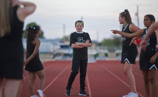 Braydon Schkade, center, takes a break from cheering with other members of the squad Thursday, Sept. 19, 2019.