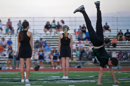 Braydon Schkade, right, performs a tumbling run during the halftime show at Grape Creek on Thursday, Sept. 19, 2019.