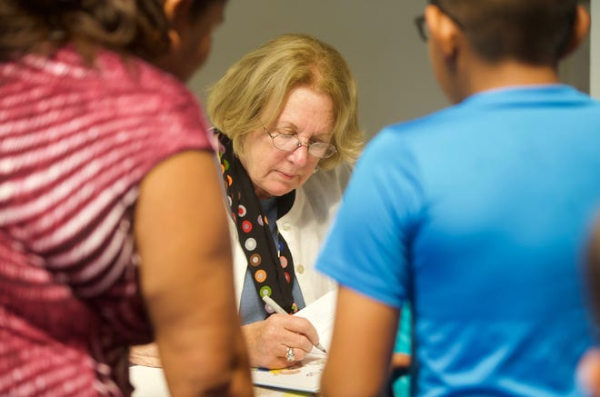Author Rosemary Wells, center, signs books for fans during an event at Stephens Central Library on Tuesday, Sept. 24, 2019.