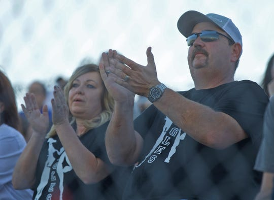 Braydon Schkade's parents, Regina and Bandy Watkins, cheer him on from the stands during a game Thursday, Sept. 19, 2019