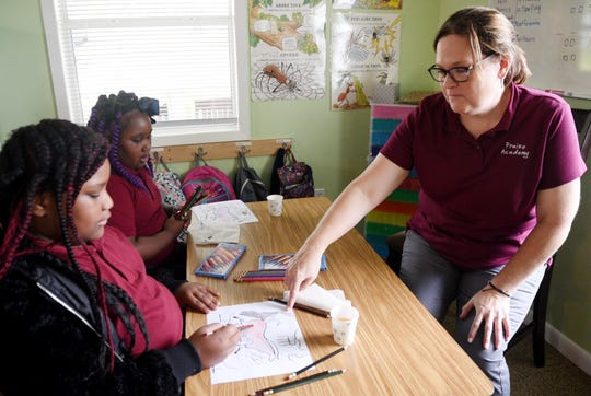 Principal of Praise Academy at Lakeside, Joan Pingel, teaches kids art history in class.