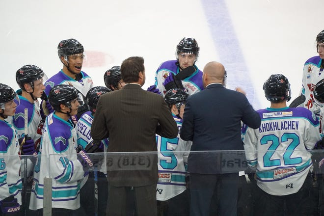 Shreveport Mudbugs head coach Jason Campbell (right) and associate head coach Rich Parent talk to the team during the first series of the season on George's Pond at Hirsch Coliseum.