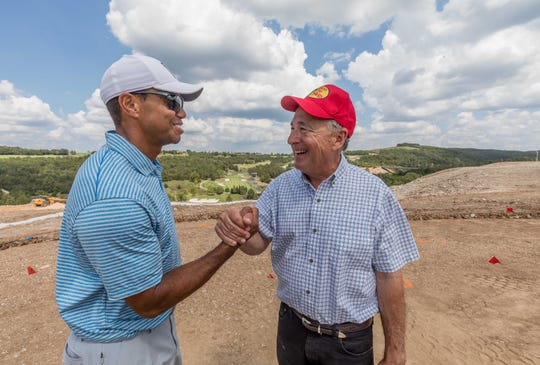 An undated publicity photo shows golf pro Tiger Woods with Bass Pro Shops founder Johnny Morris at Big Cedar Lodge near Branson, Missouri.