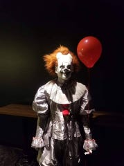 A clown waits for visitors at Field of Screams in Nixa, Mo.