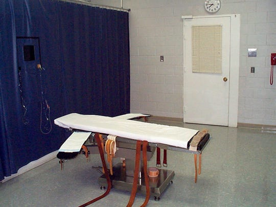 This undated file photo provided by the Virginia Department of Corrections shows the execution chamber at the Greensville Correctional Center in Jarratt. Prison officials are unconstitutionally limiting public access to executions in Virginia by blocking witnesses from seeing certain steps in the process, The News Leader and other news organizations allege in a federal lawsuit filed Monday.