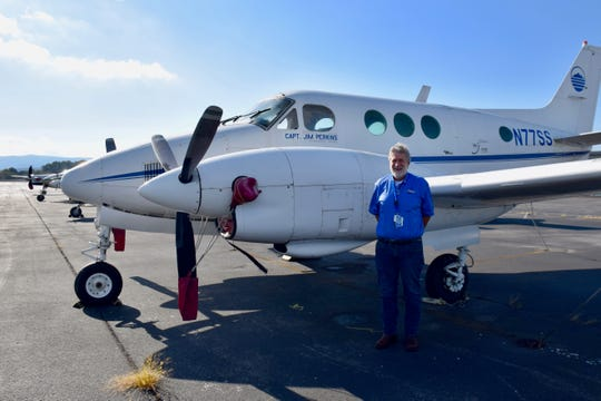 Fred Dyen, aviation maintenance technology professor at Blue Ridge Community College, poses by a BRCC training airplane on Sept. 24, 2019. The program, like BRCC as a whole, has seen declining enrollment since the Great Recession.