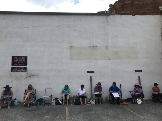 Sketch Staunton members sketching outside Cranberry's Grocery in June 2019.