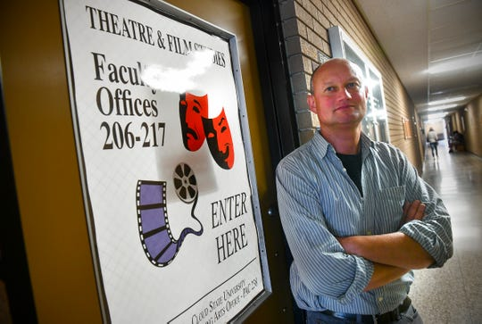 Associate professor of theater and film studies Vladimir Rovinsky stands near the entrance to the department Thursday, Sept. 26, 2019, at the Performing Arts Center at St. Cloud State University.