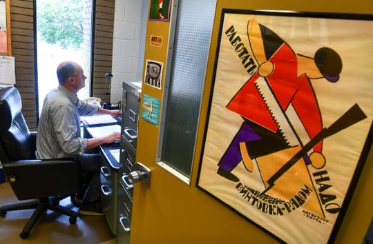 Associate professor of theater and film studies Vladimir Rovinsky works in his office Thursday, Sept. 26, 2019, at the Performing Arts Center at St. Cloud State University.