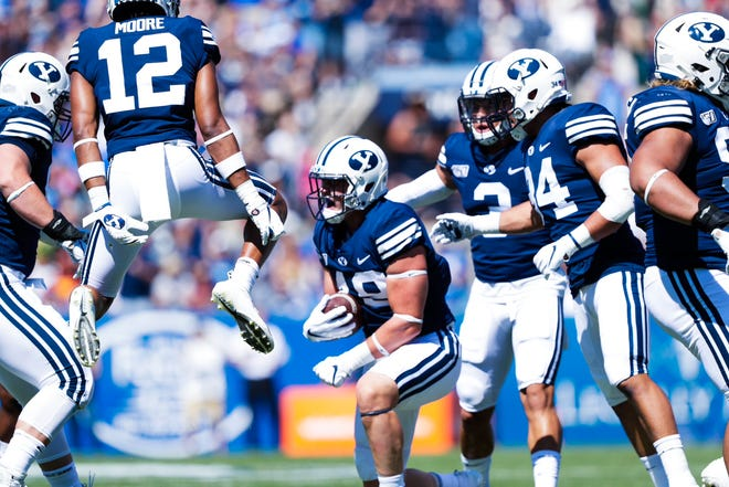 BYU linebacker and Dixie High Payton Wilgar (center) after making a key interception against USC.