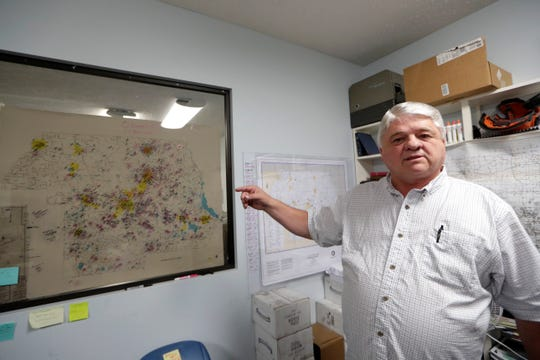 Coba Beasley with the Chipola Baptist Association shows a map that he and his team have created to map out those in that are still in need of help to recover from Hurricane Michael Wednesday, Sept. 11, 2019.
