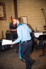 Rev. William Levwood breaks into dance after his ordination service at the Unitarian Universalist Church
