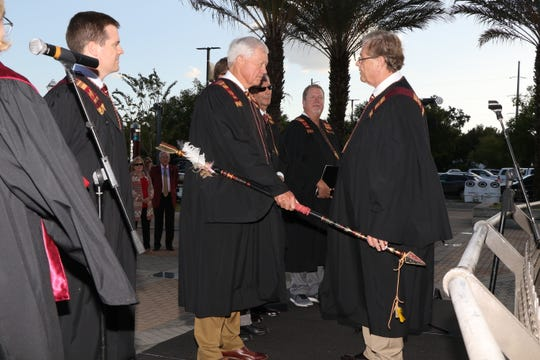 Jim Henderson lights the spear the night before the Louisville game.