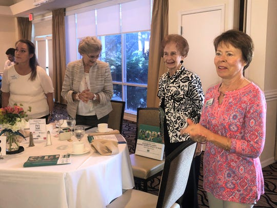 Betty Lahti, second from right, receives a standing ovation after being named the Barbara Trimble Legacy of Hope Award recipient at the 2019 Hope Awards Recognition Breakfast. Pictured with Lahti are, from left, Robin Cartwright, Suzanne Hortsman and Deborah Lovequist.