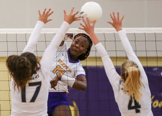 Fort Pierce Central's Brianna Jackson (center) hits the ball over the net past William T. Dwyer defenders during a high school volleyball match at Fort Pierce Central High School on Wednesday, Sept. 25, 2019, in Fort Pierce.