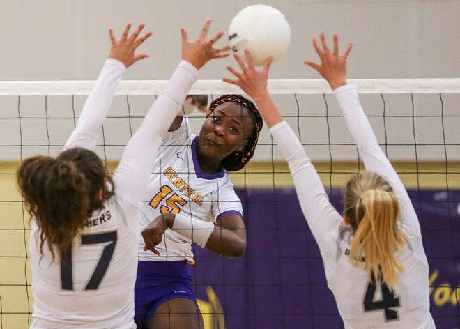 Fort Pierce Central's Brianna Jackson hit the ball past two Dwyer defenders in 2019. The start of volleyball, and all other fall sports, has been delayed until Aug. 24.