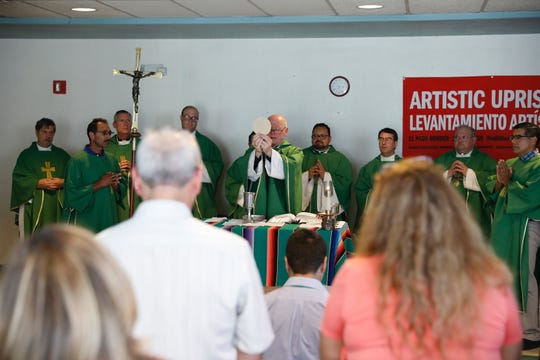 Bishop Brendan J. Cahill from the Diocese of Victoria leads a small service at Centro Sin Fronteras Farm Worker's Center in Downtown El Paso on Wednesday night, Sept. 25, 2019, before a group of 50.
