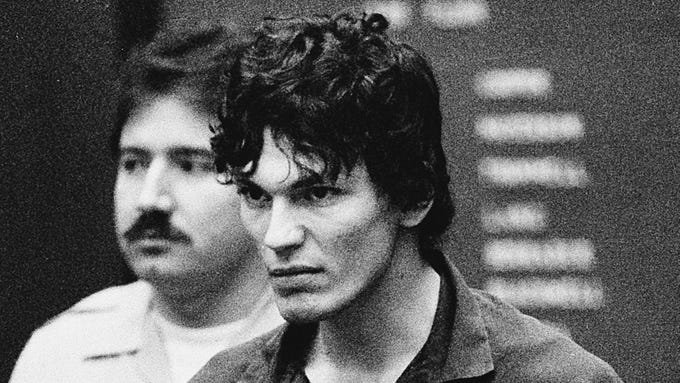 "In this file photo taken Oct. 21, 1985, Richard Ramirez, accused of multiple counts of murder in the ""Night Stalker"" serial killings, clenches his fists and pulls on his restraints in a court appearance in Los Angeles. The California Supreme Court Monday, Aug. 7, 2006, upheld the convictions and death sentence for serial killer Richard Ramirez, the so-called ""Night Stalker"" whose killing spree terrorized the Los Angeles area in the mid 1980s. Ramirez, now 46, was sentenced to death in 1989 for 13 Los Angeles-area murders committed in 1984 and 1985. Satanic symbols were left at some murder scenes and some victims were forced to ""swear to Satan"" by the killer, who broke into homes through unlocked windows and doors. (AP Photo/Lennox McLendon)"