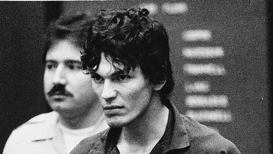 """** FILE ** In this file photo taken Oct. 21, 1985, Richard Ramirez, accused of multiple counts of murder in the """"Night Stalker"""" serial killings, clenches his fists and pulls on his restraints in a court appearance in Los Angeles. The California Supreme Court Monday, Aug. 7, 2006, upheld the convictions and death sentence for serial killer Richard Ramirez, the so-called """"Night Stalker"""" whose killing spree terrorized the Los Angeles area in the mid 1980s. Ramirez, now 46, was sentenced to death in 1989 for 13 Los Angeles-area murders committed in 1984 and 1985. Satanic symbols were left at some murder scenes and some victims were forced to """"swear to Satan"""" by the killer, who broke into homes through unlocked windows and doors. (AP Photo/Lennox McLendon)"""