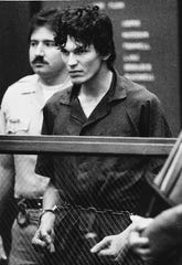 "** FILE ** In this file photo taken Oct. 21, 1985, Richard Ramirez, accused of multiple counts of murder in the ""Night Stalker"" serial killings, clenches his fists and pulls on his restraints in a court appearance in Los Angeles. The California Supreme Court Monday, Aug. 7, 2006, upheld the convictions and death sentence for serial killer Richard Ramirez, the so-called ""Night Stalker"" whose killing spree terrorized the Los Angeles area in the mid 1980s. Ramirez, now 46, was sentenced to death in 1989 for 13 Los Angeles-area murders committed in 1984 and 1985. Satanic symbols were left at some murder scenes and some victims were forced to ""swear to Satan"" by the killer, who broke into homes through unlocked windows and doors. (AP Photo/Lennox McLendon)"