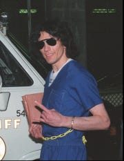 "FILE--Richard Ramirez, also known as the ""Night Stalker"" serial killer, responds to reporters after hearing the verdict in his trial, Sept. 20, 1989. Ramirez, presently serving time on San Quentin's Death Row in Northern California, is scheduled to get married Thursday, Oct. 3, 1996, to a woman relatives say has had an unusual fascination with the killer since he was arrested for torturing, sexually abusing and murdering 13 people in Southern California.(AP Photo/Alan Greth)"