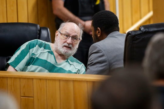 Former Catholic priest Thomas Ericksen consults with defense attorney Ryan Reid during a sentencing hearing on Thursday, September 26, 2019, at Sawyer County Courthouse in Hayward, Wis. Ericksen was sentenced to a total of 30 years in prison on two counts of sexual assault of a child.