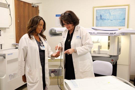 Radiology supervisor Lynda Zingaro, left, and Dr. Caren E. Greenstein, radiologist and director of breast imaging, demonstrate the SAVI SCOUT technology, a new technique that uses an infrared reflector to localize areas to be removed during breast surgery, at the White Plains Hospital Center Sept. 26, 2019.