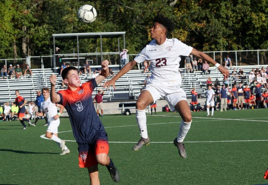 From left, Horace Greeley's  Alexander Mancini (3) and Ossining's Yohance Douglas (23) battle for ball control during boys soccer action at Horace Greeley High School in Chappaqua Sept. 25, 2019.  Greeley won the game 3-2.