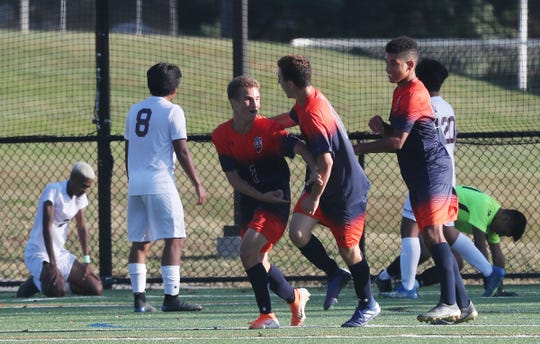 From left, Horace Greeley's  Zachary Eichenberg (2) celebrates with teammates after his first half goal against Ossining during boys soccer action at Horace Greeley High School in Chappaqua Sept. 25, 2019.  Greeley won the game 3-2.