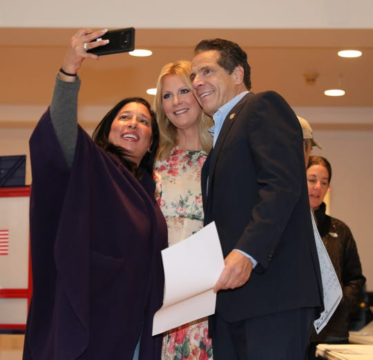 New York Governor Andrew Cuomo and girlfriend Sandra Lee take a selfie with a voter as they prepare to vote at the Presbyterian Church of Mount Kisco, Nov. 6, 2018.