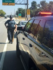 Delaware State Police giving a driver a citation.